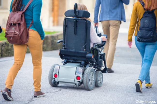 Electric wheelchair user